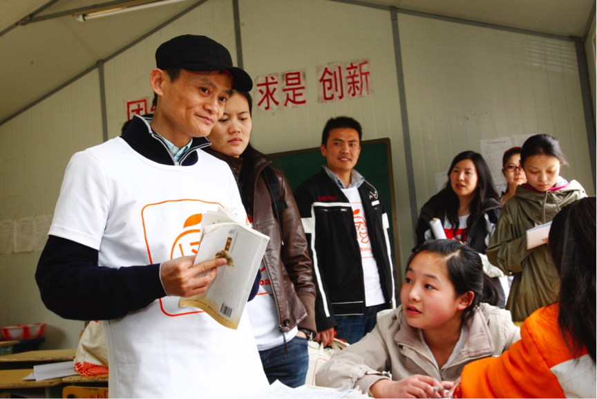 Jack Ma, executive chairman of Alibaba Group, joins volunteers in the quake-affected county, Qingchuan, in 2009.