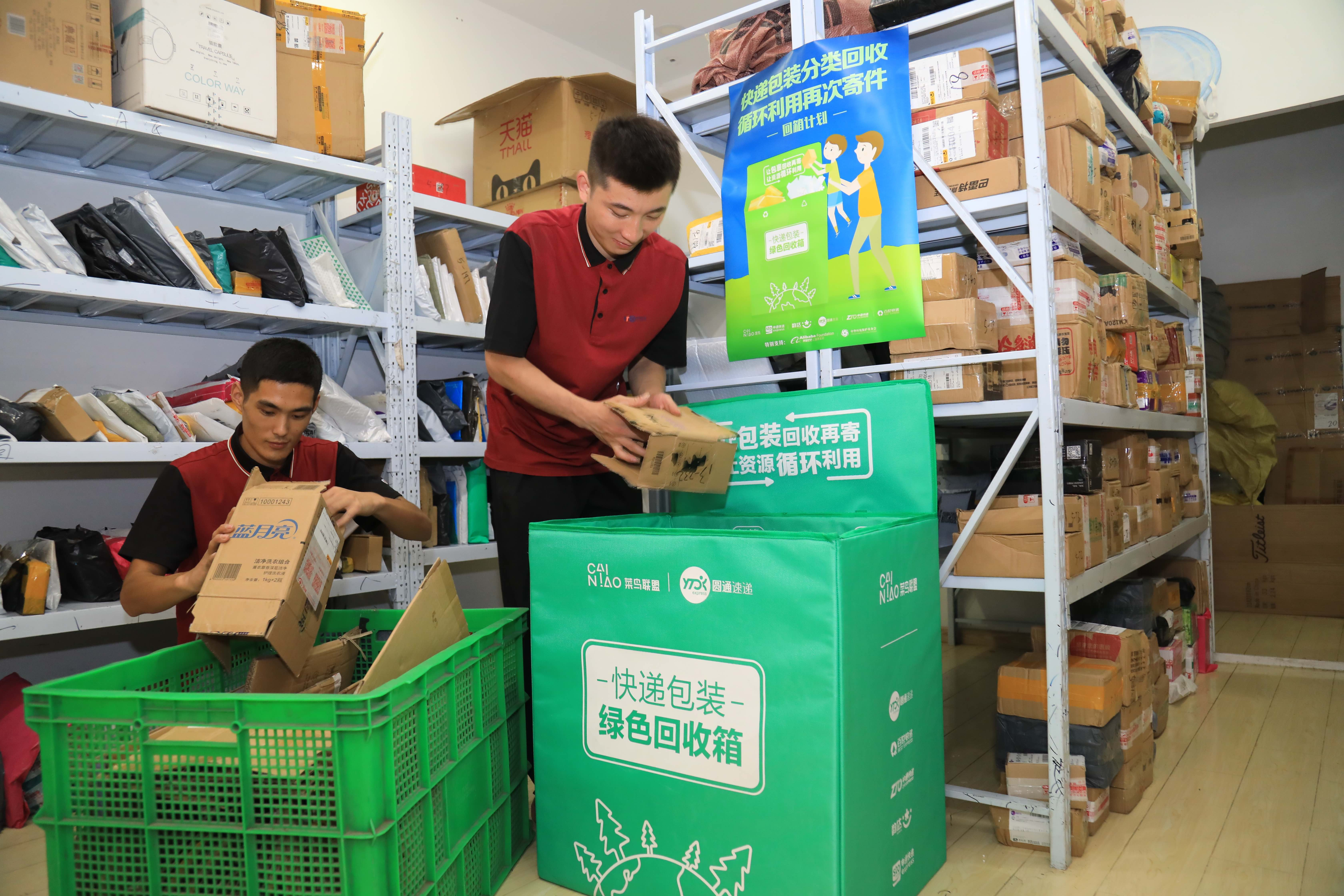 Couriers sorting out recycled boxes